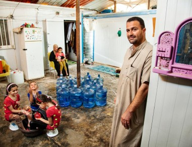 The Abu Noqta family, Syrians living in Jordan's Za'atari refugee camp, need 380 litres of water daily, including to stay cool amid brutal temperatures. © UNICEF/NYHQ2015–1887/Gilbertson VII